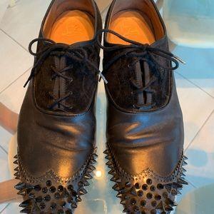 Christian Louboutin spiked black tie dress shoe
